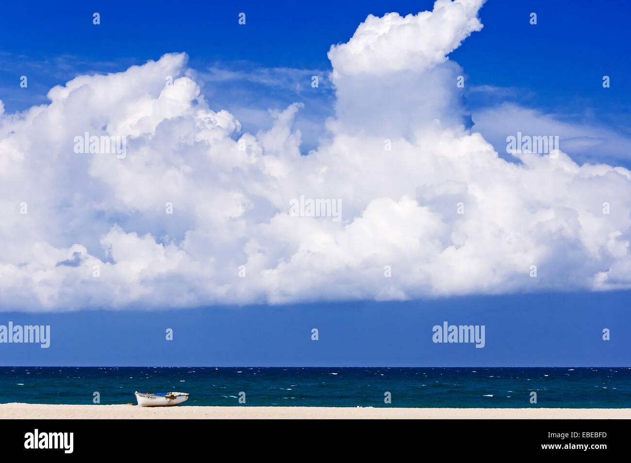 Boat lying on deserted beach Stock Photo