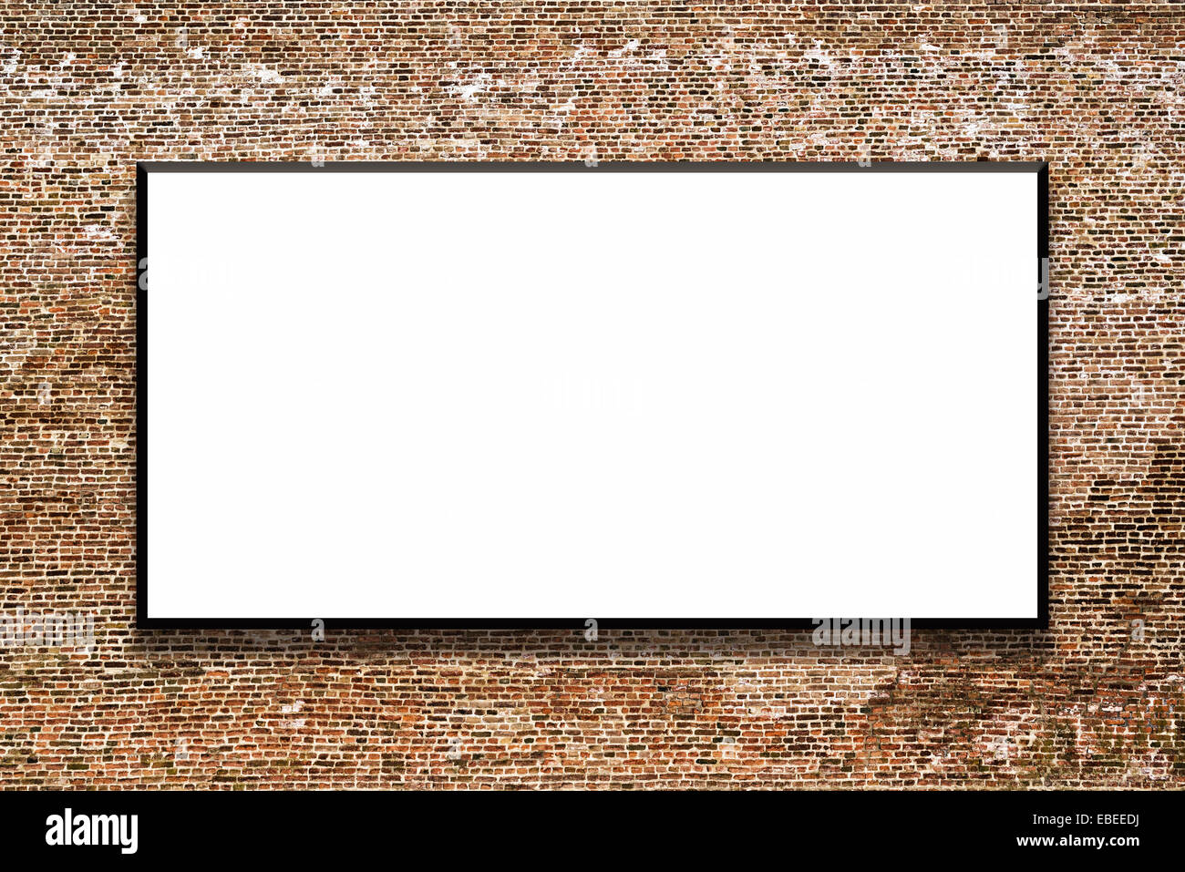 Big empty billboard attached to a brick wall as outdoor advertising copy space. - Stock Image