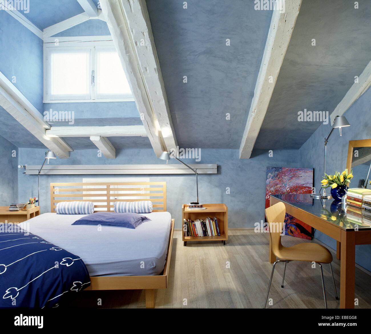 interior view of a modern bedroom in the attic room with wood floor