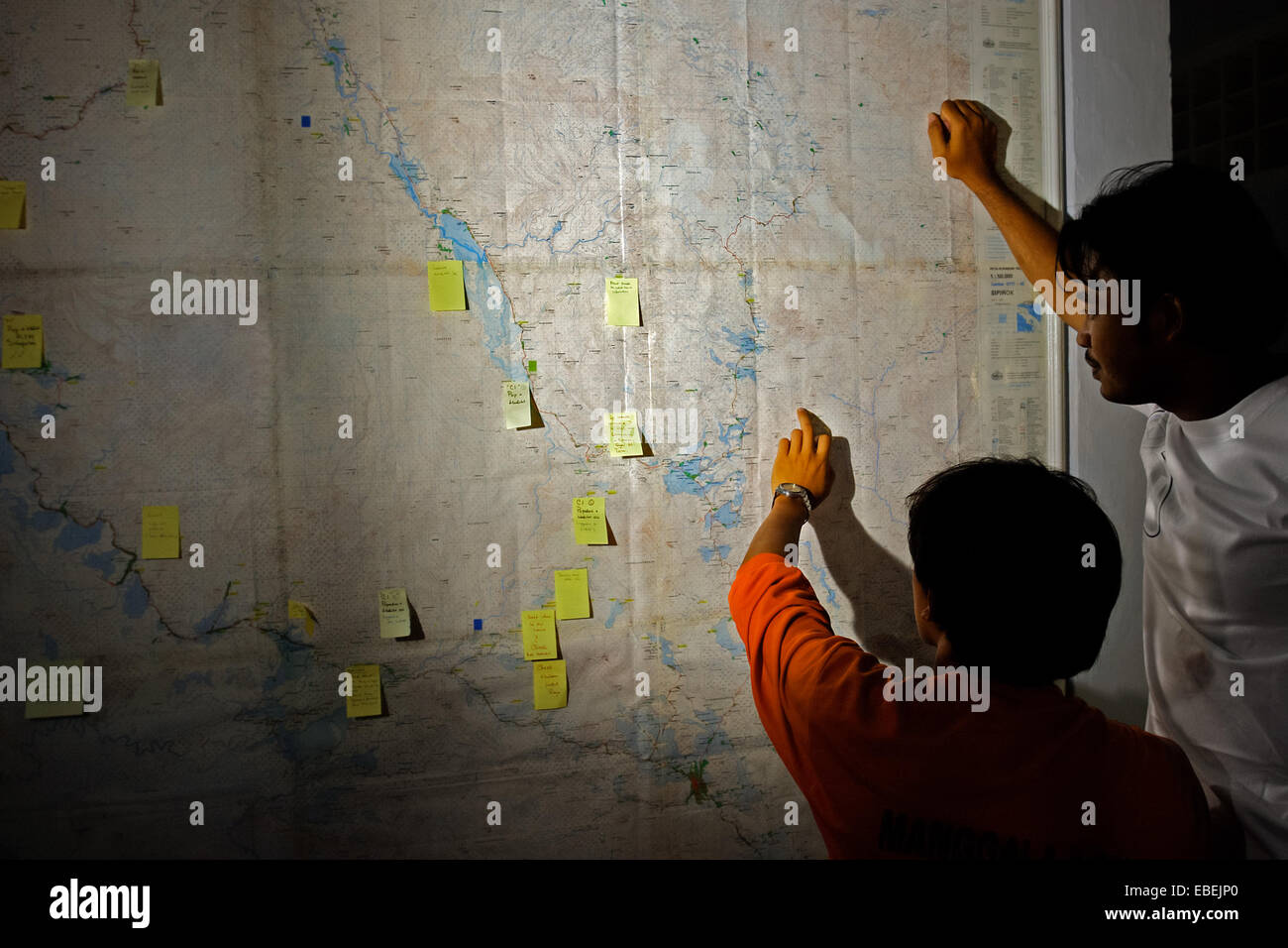 Conservationists reading map during a wildlife and habitat survey in Sumatra, Indonesia. - Stock Image