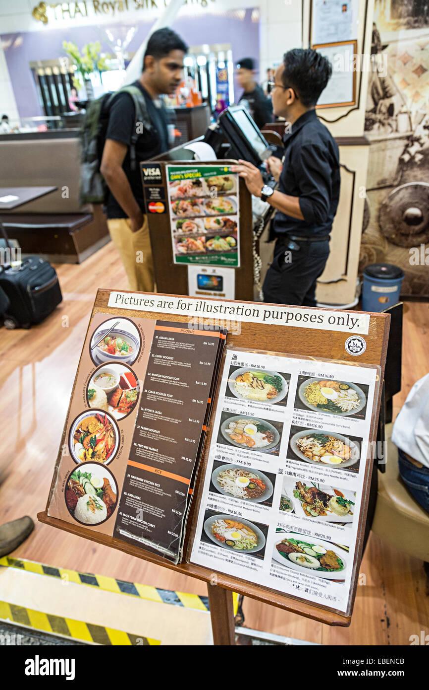 Illustrated menu for Malaysian food at restaurant in Kuala Lumpur airport - Stock Image
