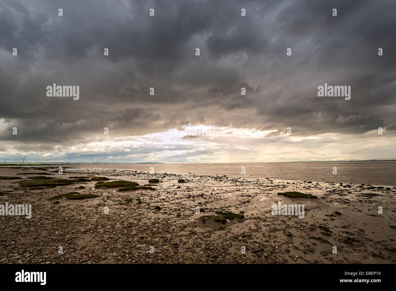Muddy bank of the River Severn ner the second road bridge, England, UK - Stock Image