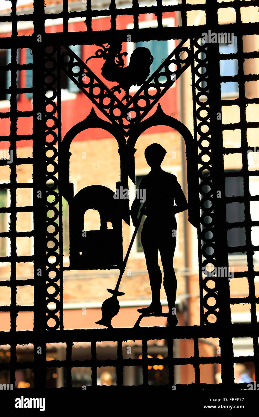 Venice Italy Murano architecture silhouette of glass blower on iron gate - Stock Image