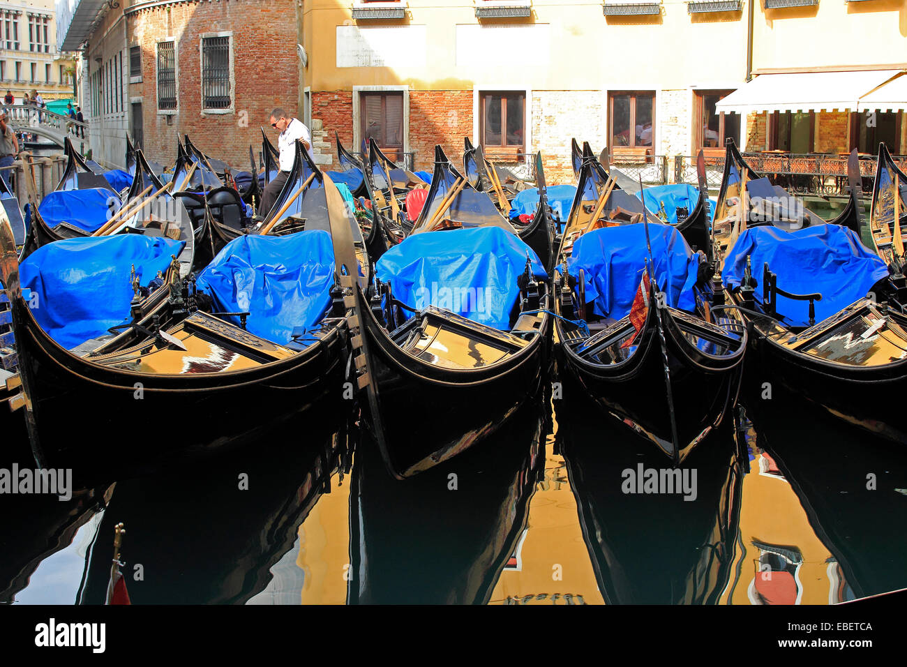 Venice Italy Piazza San Marco many gondolas in the Bacino Orseolo by St. Marks - Stock Image