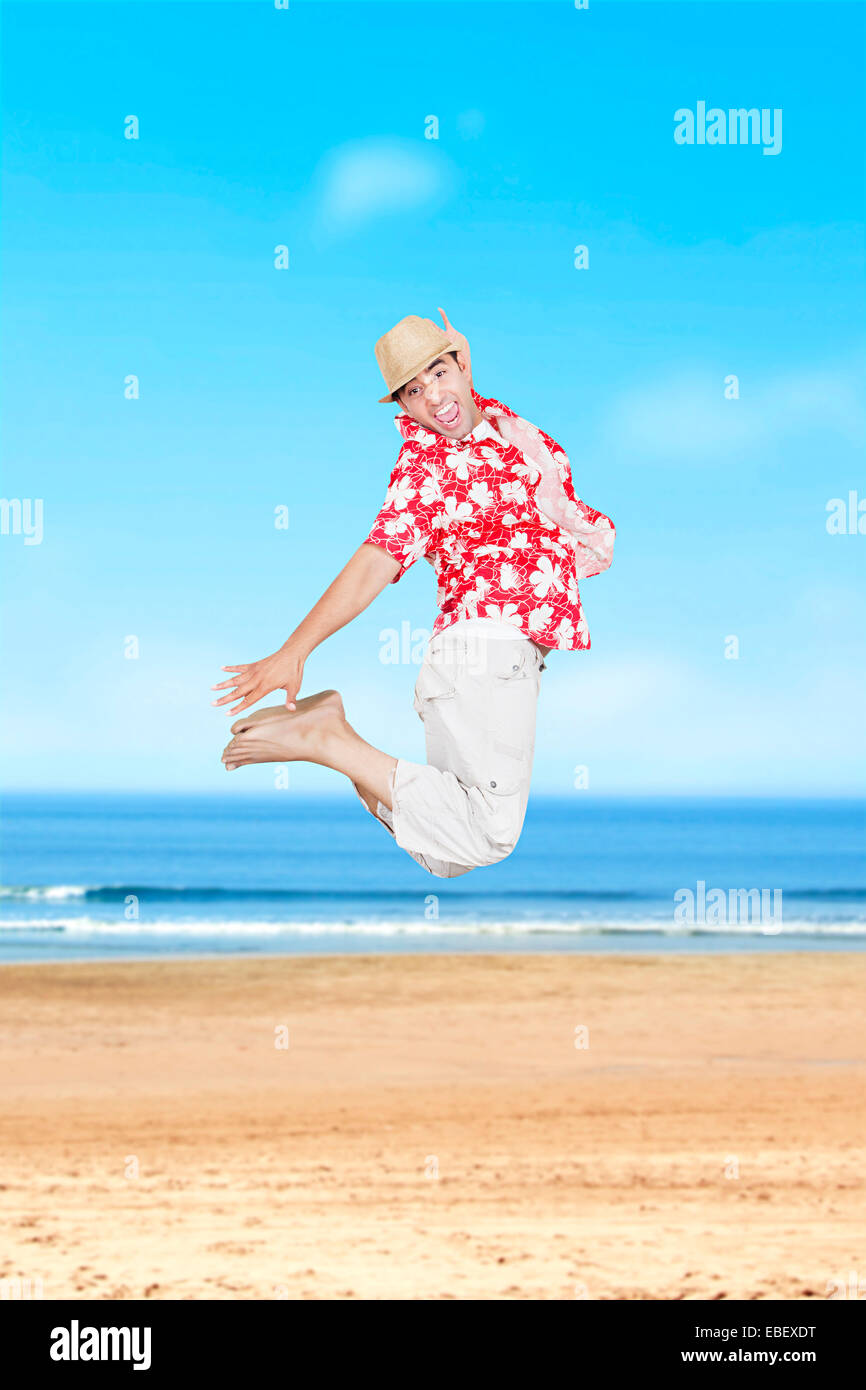 indian man Beach Jumping - Stock Image