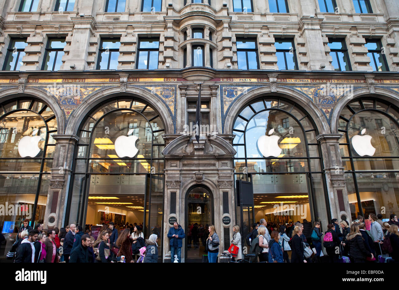 LONDON, UK - NOVEMBER 29TH 2014: Crowds of shoppers flood past the Apple store on Regent Street in London, on 29th Stock Photo