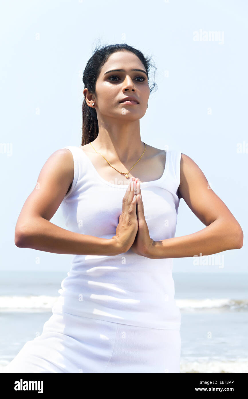 indian lady beach Yoga - Stock Image