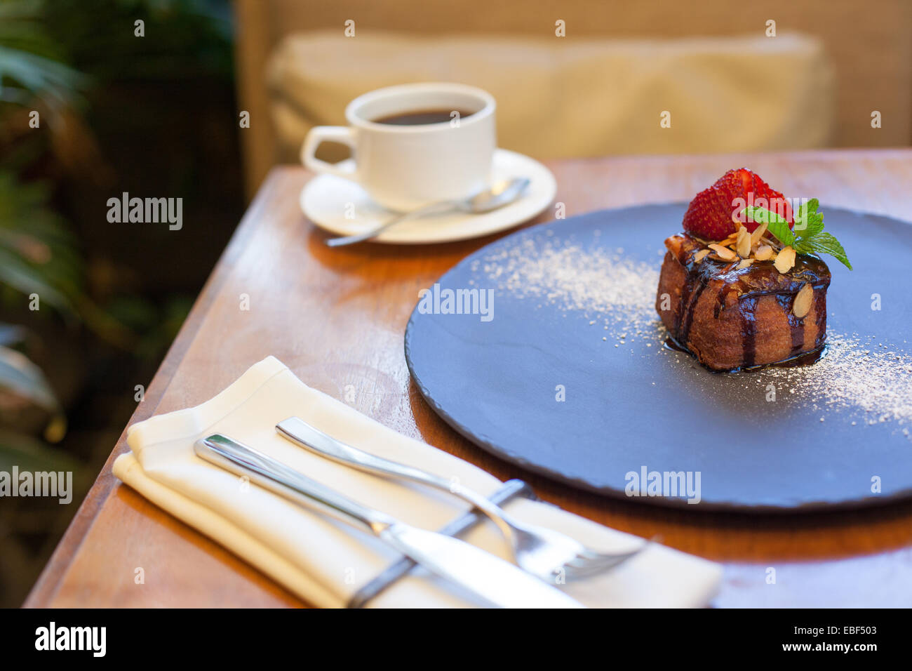 Pastry dessert with coffee on table in high end restaurant - Stock Image