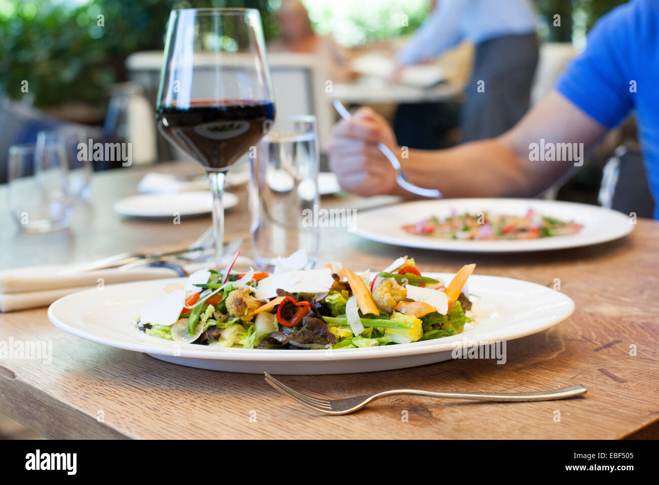 Upscale salads on table in high end restaurant - Stock Image
