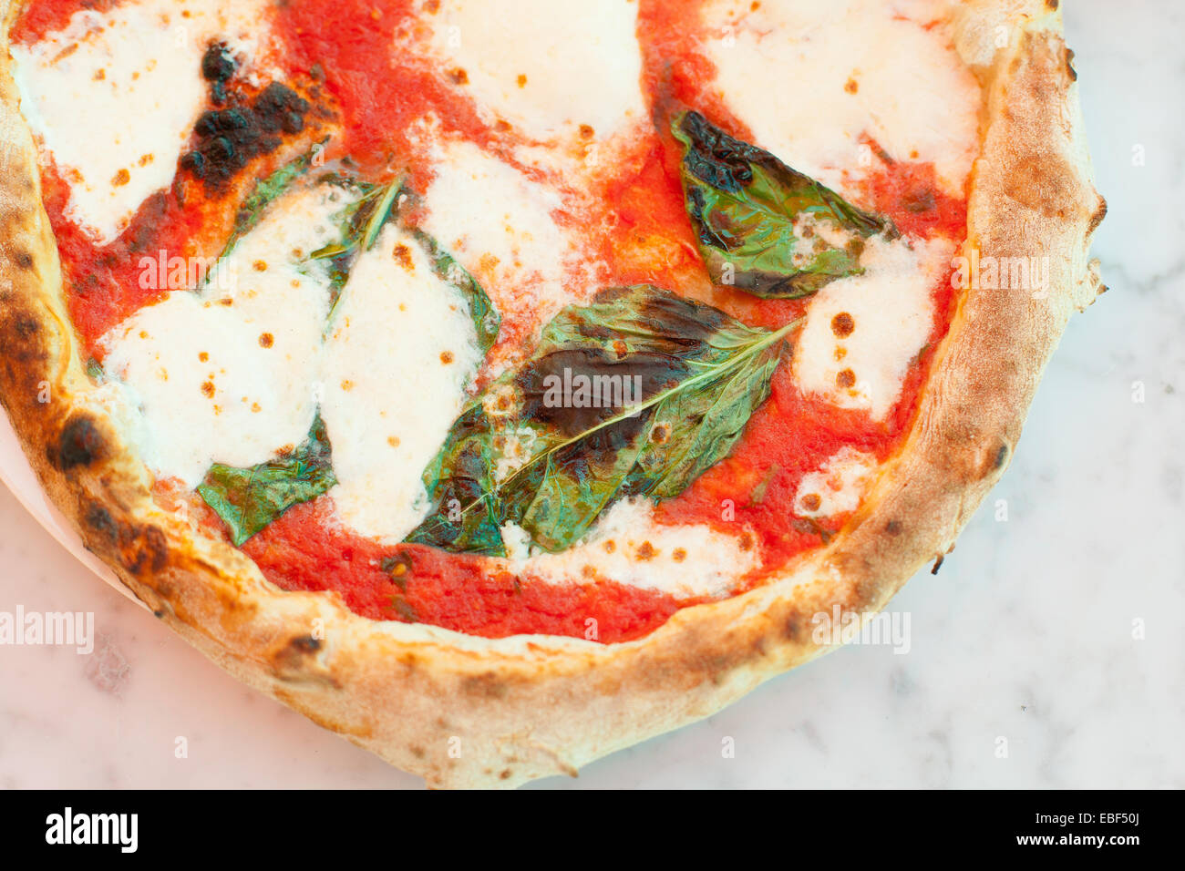 Overhead Of Oven Wood Fired Margherita Pizza