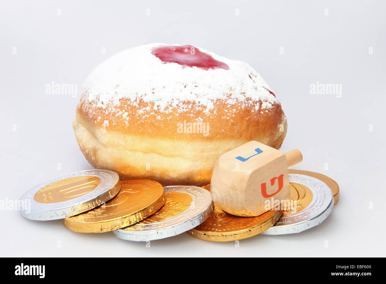 Hanukkah doughnut and spinning top - Traditional jewish holiday food and toy. - Stock Image