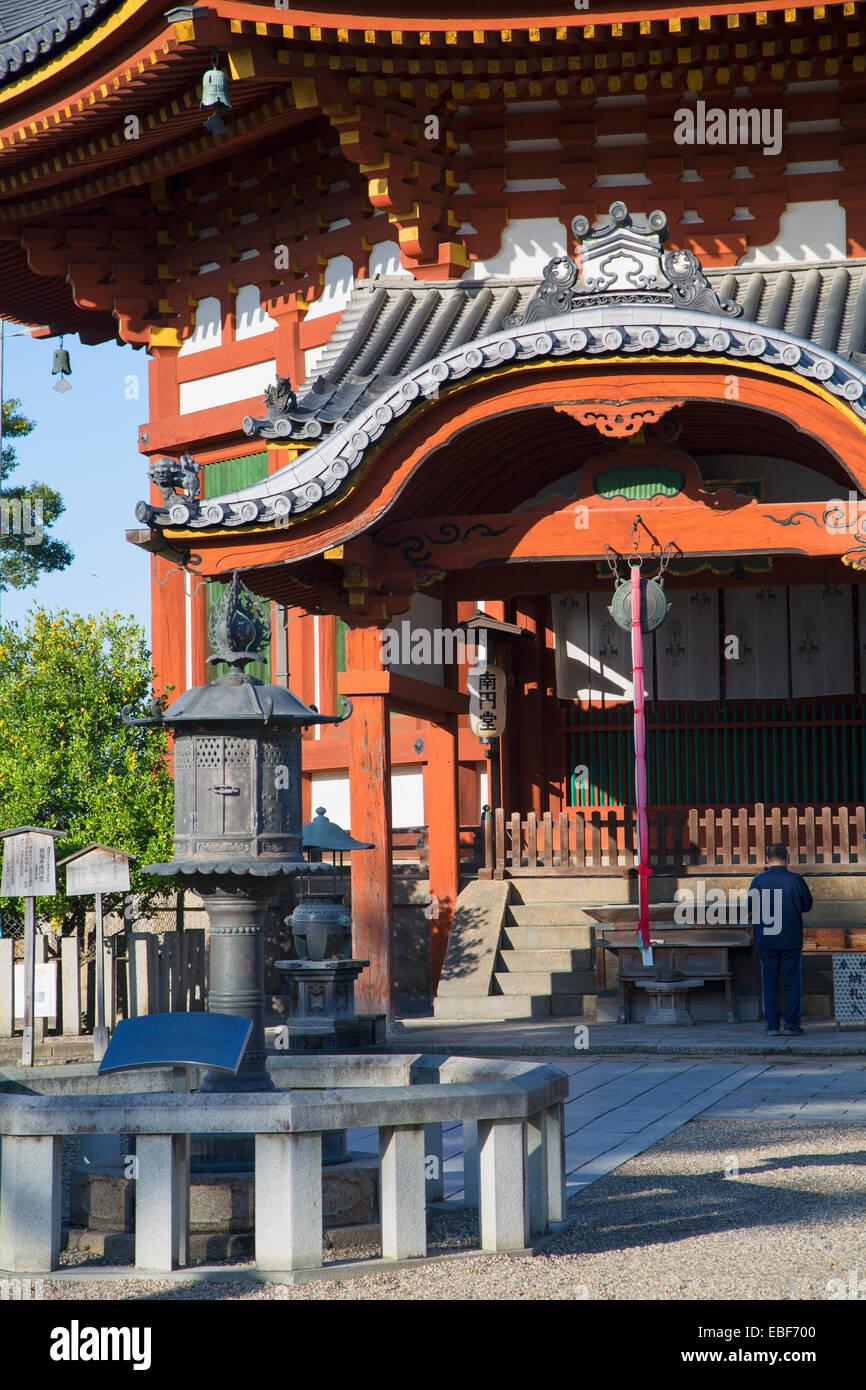 Man praying at pagoda at Kofuku-ji Temple (UNESCO World Heritage Site), Nara, Kansai, Japan - Stock Image