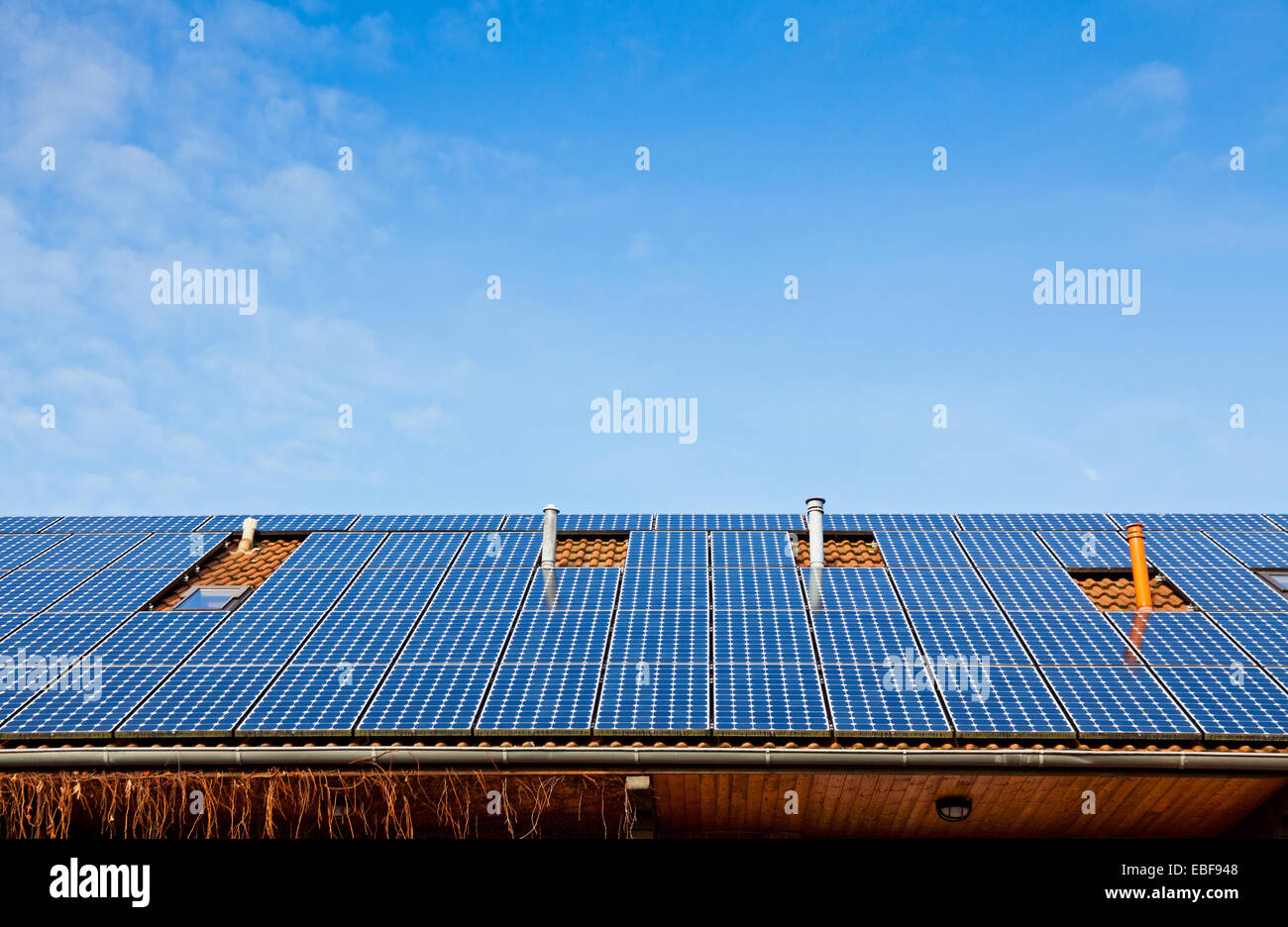 Solar panels installed on the roof of building - Stock Image