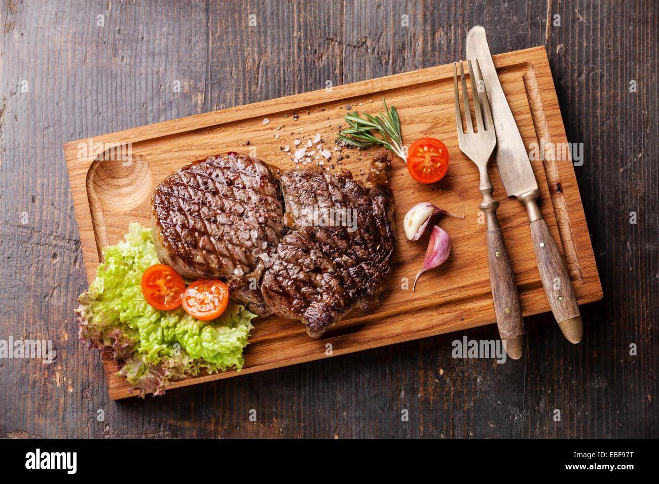 Medium rare grilled Beef steak Ribeye on cutting board on ... | 1300 x 956 jpeg 287kB