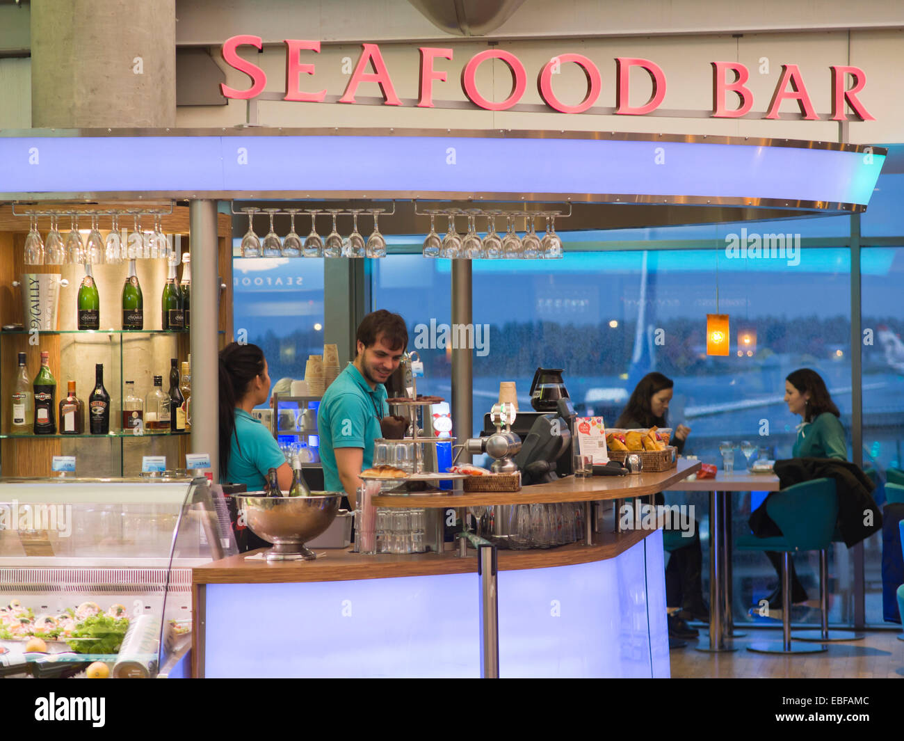 Oslo Airport, Gardermoen, departure hall has seafood bar for both national and international travel - Stock Image