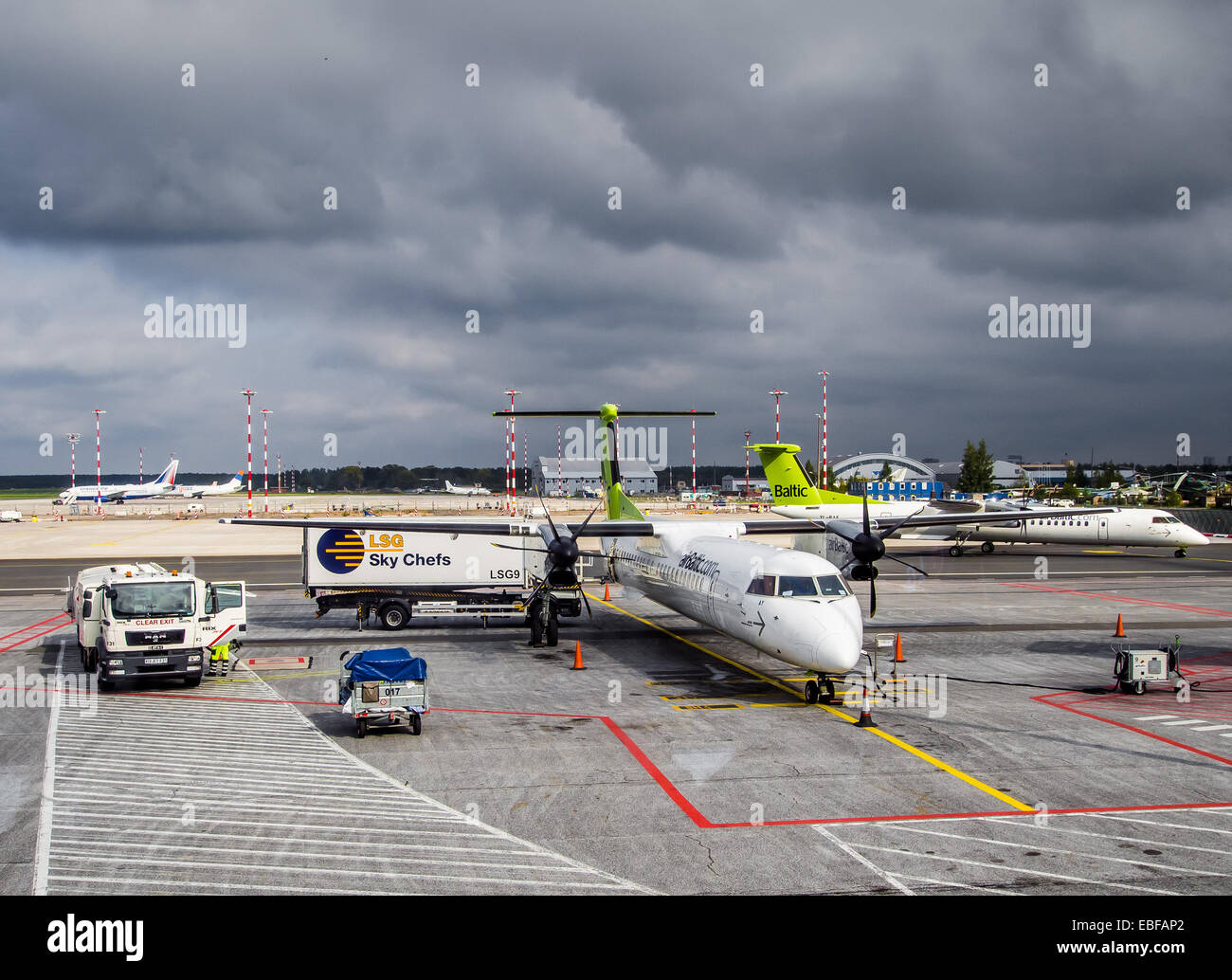 Preflight service of the plane of airline Airbaltic - Stock Image