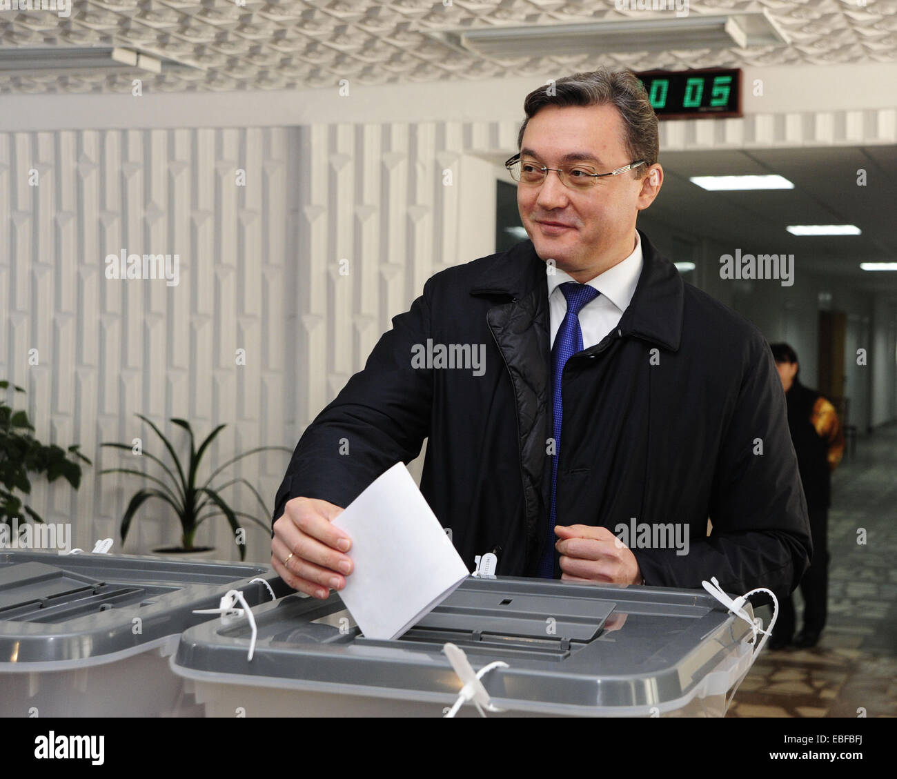 Chisinau. 30th Nov, 2014. Moldovan Parliament Speaker Igor Corman casts his vote a voting booth during a parliamentary Stock Photo
