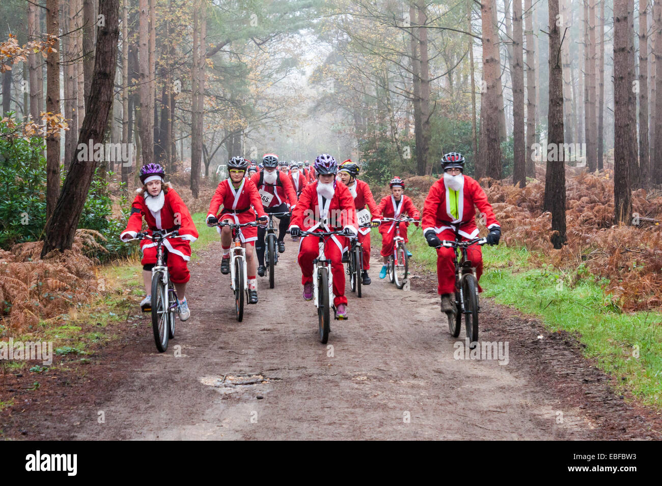 Fund-raisers dressed as Santas cycled in the 'Santa Cycle', part of the annual 'Santa Dash' to raise money for the Stock Photo