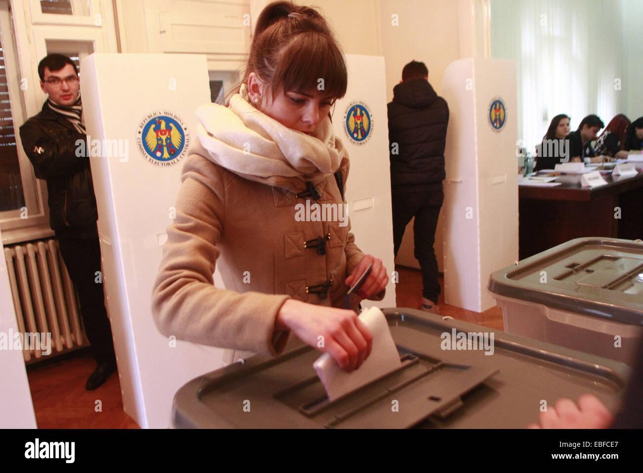 Bucharest, Romania. 30th Nov, 2014. Moldovan citizens vote at the Moldova' s Embassy in Bucharest, capital of Romania, Stock Photo