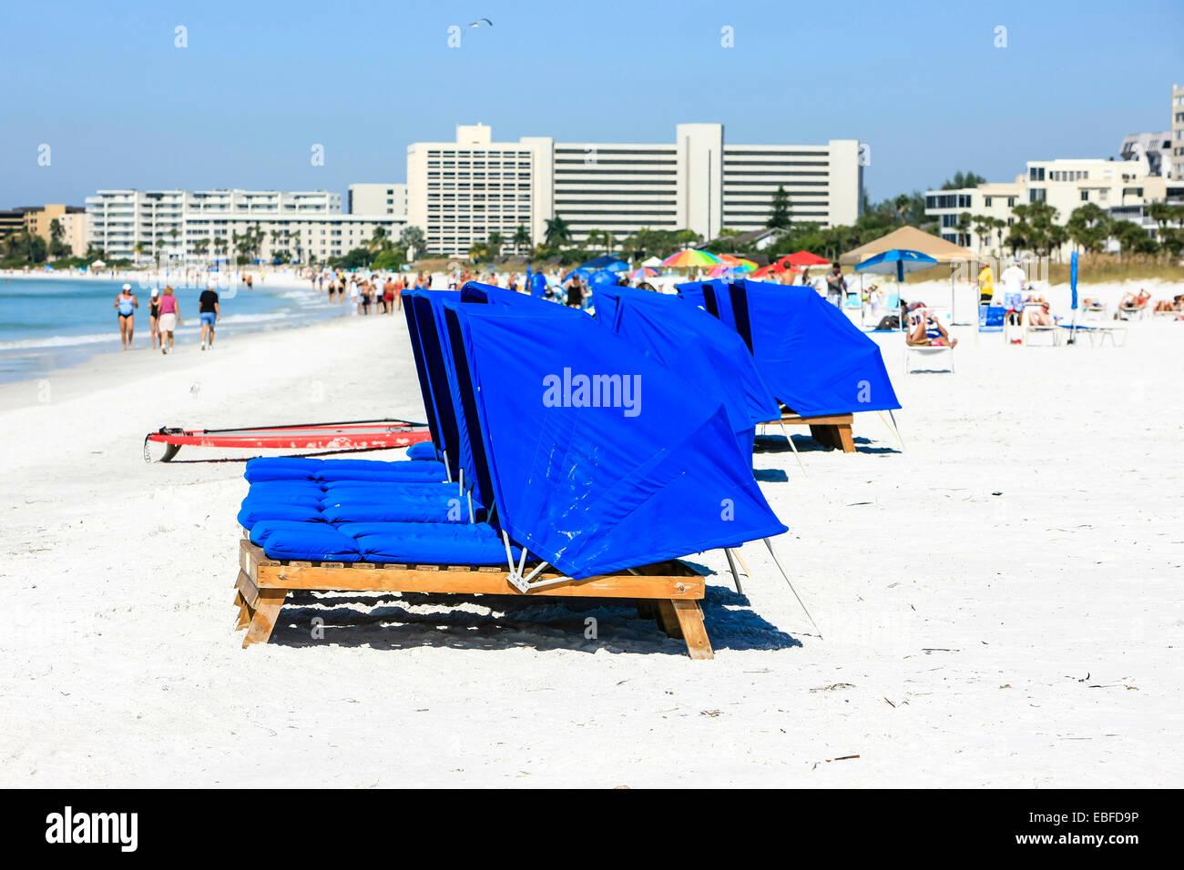 Blue beach Cabanas on Crescent beach on Siesta Key Island in Sarasota FL - Stock Image