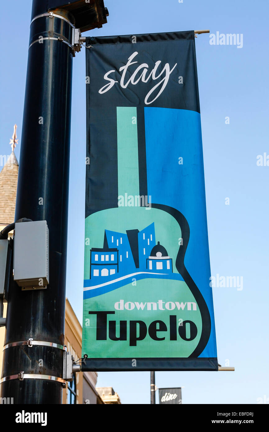Stay Downtown Tupelo - City banner seen in Main Street, the hometown of Elvis in Mississippi - Stock Image
