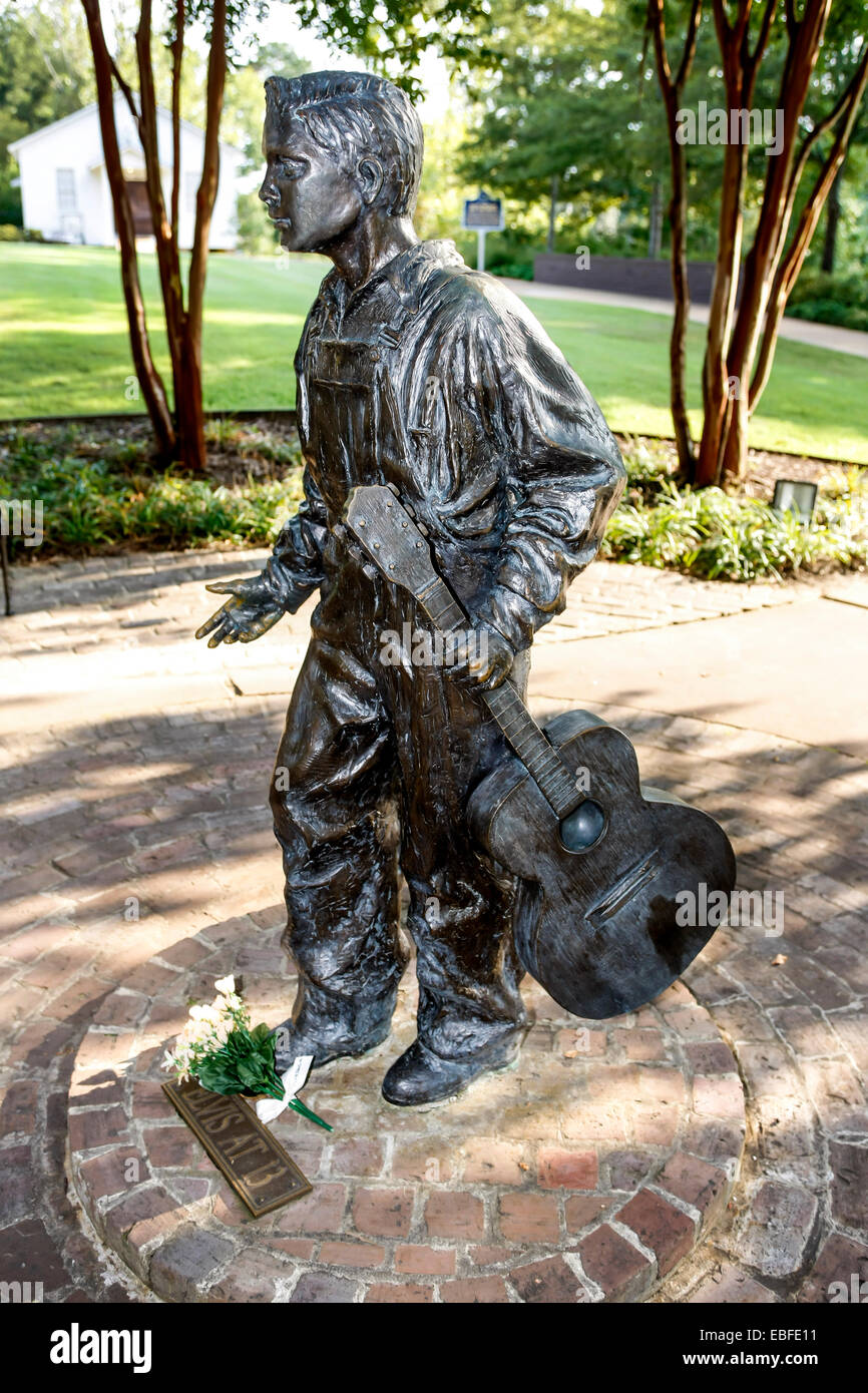 Statue of Elvis as a young boy dedicated to his fans set in the grounds of his birthplace museum in Tupelo MS - Stock Image