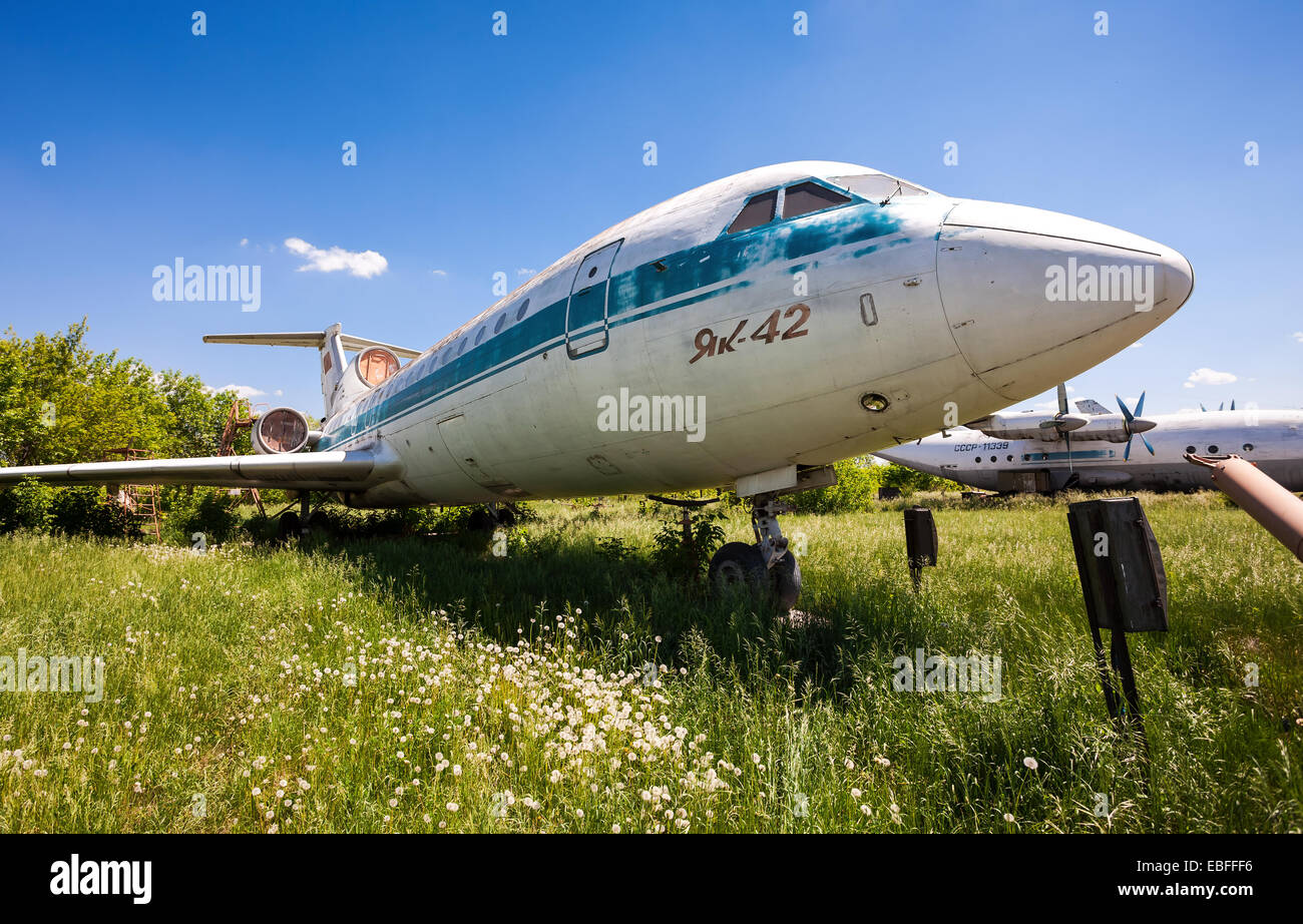 SAMARA, RUSSIA - MAY 25, 2014: Old russian aircraft Yak-42 at an abandoned aerodrome in summertime - Stock Image