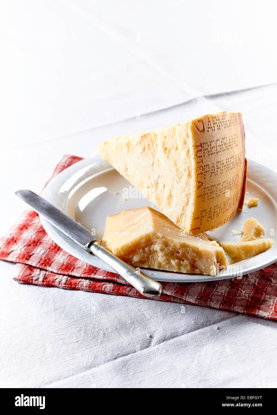 Still life of piece of parmesan cheese with knife - Stock Image