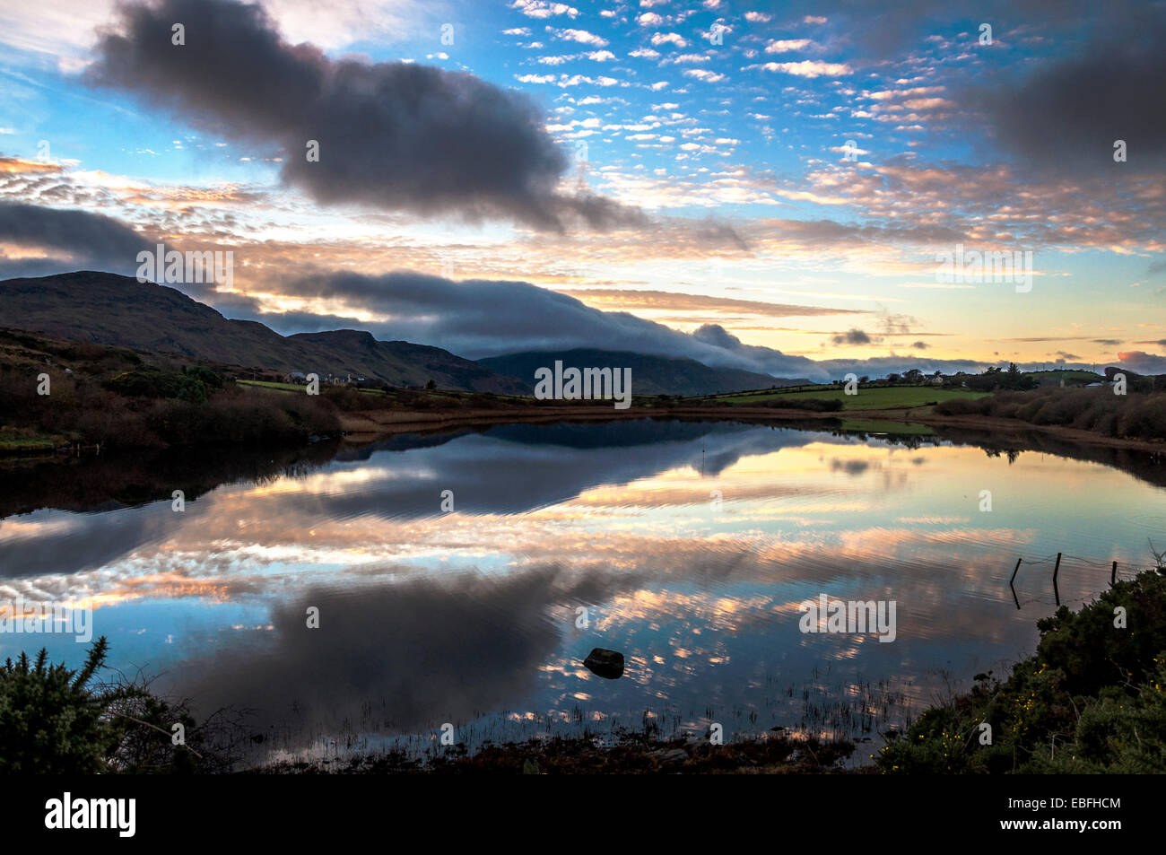 Lake Shanaghan, Ardara, County Donegal, Ireland. 30th November, 2014. Interesting cloud patterns and shapes reflected - Stock Image