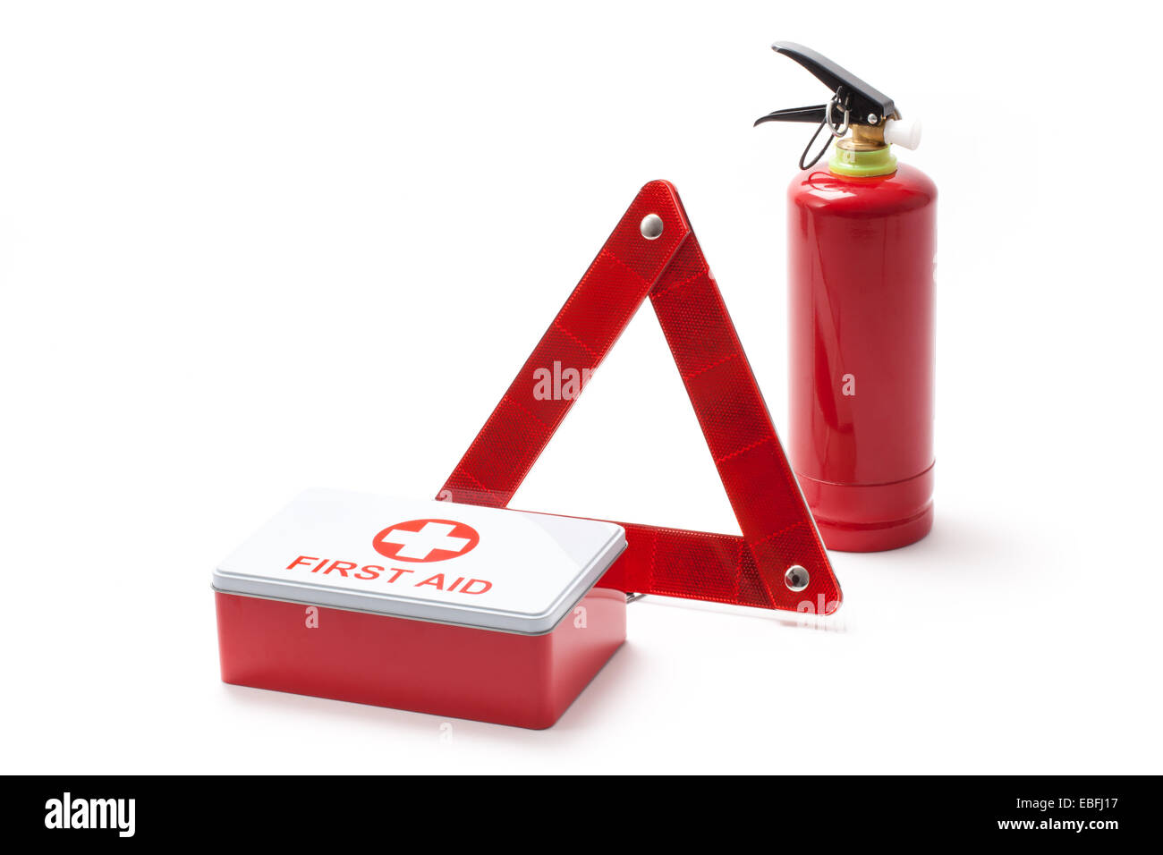 Car equipment - triangle, extinguisher and first aid kit. - Stock Image