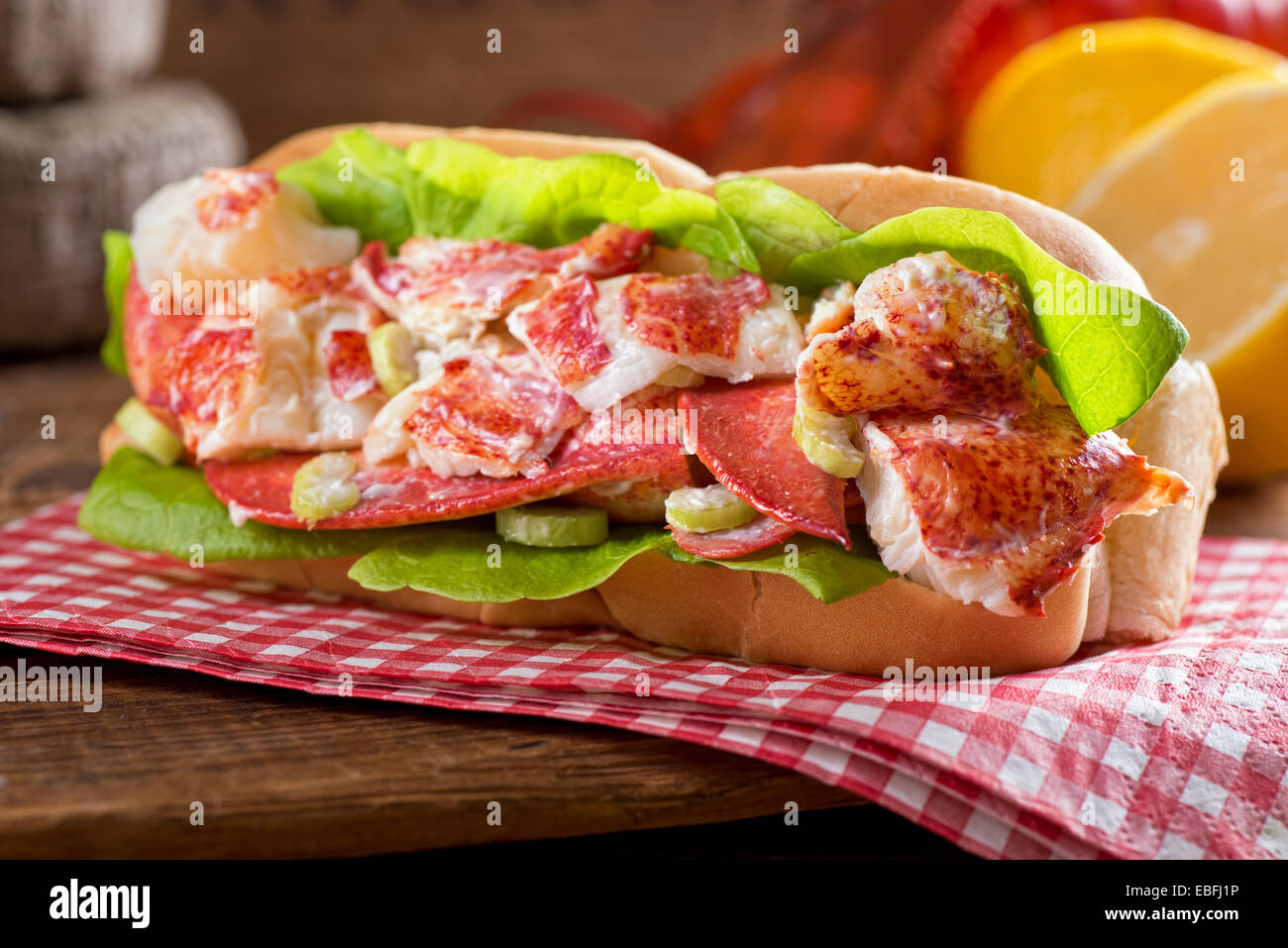 A delicious freshly made lobster roll with lobster, lemon, celery, and mayonnaise. - Stock Image