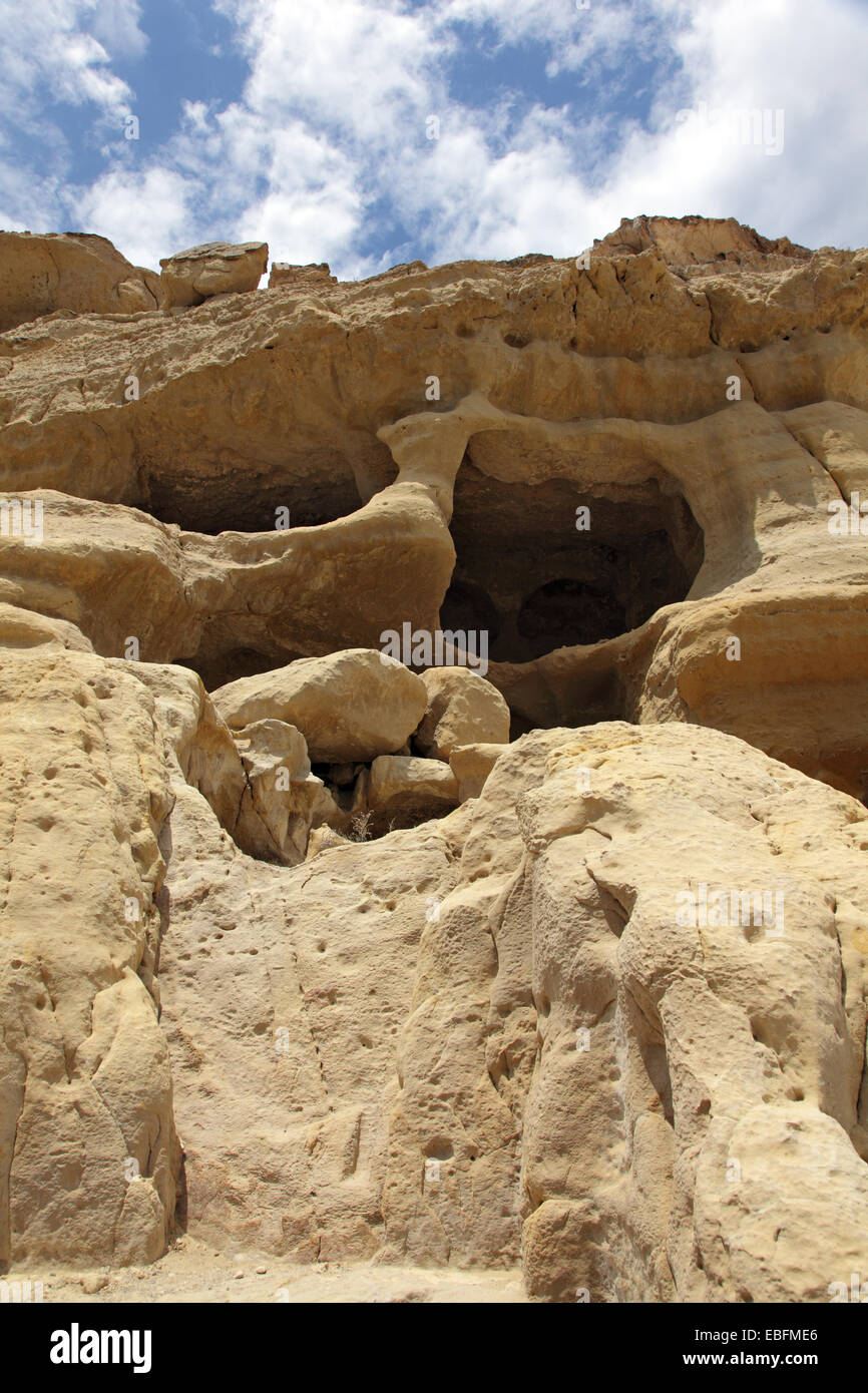 Matala on the Greek island of Crete has become famous for the artificial caves, carved into the rocks. Tombs found Stock Photo