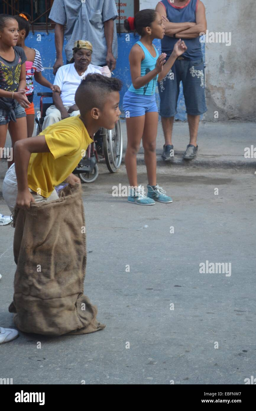 Children participating in a Sack Race during a school sports day on the streets of Havana, Cuba - Stock Image