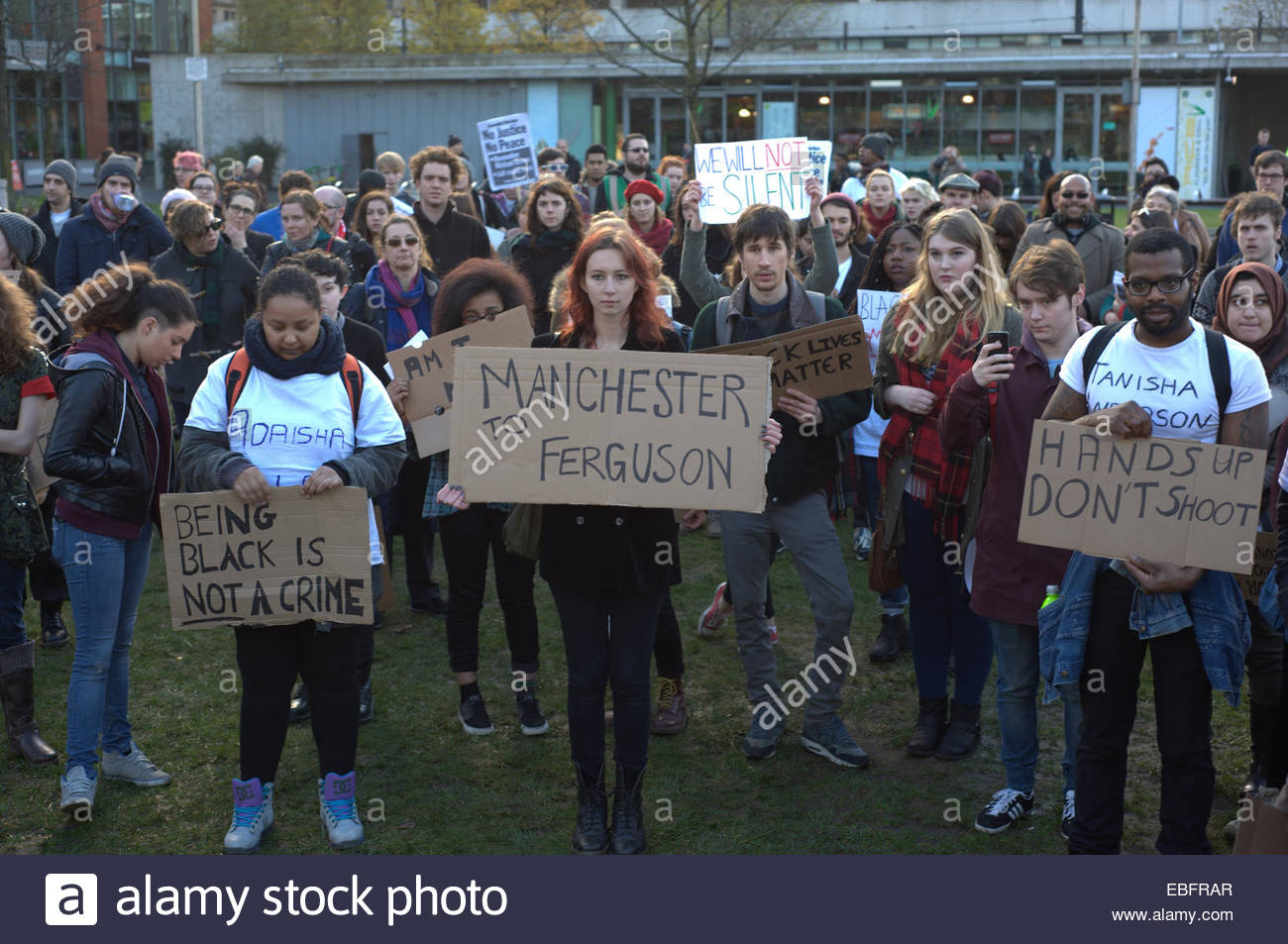 People, of various ethnicities, standing together in order to demand justice for Michael Brown. People of different - Stock Image