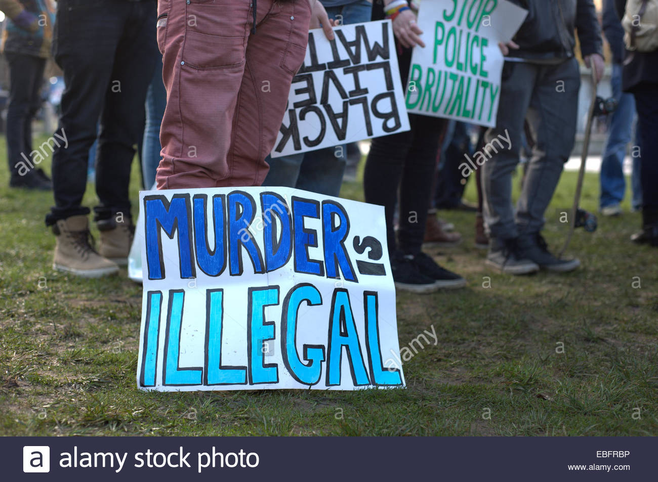 A placard showing that 'Murder is illegal'. People of different ethnicities joined together and held a rally - Stock Image