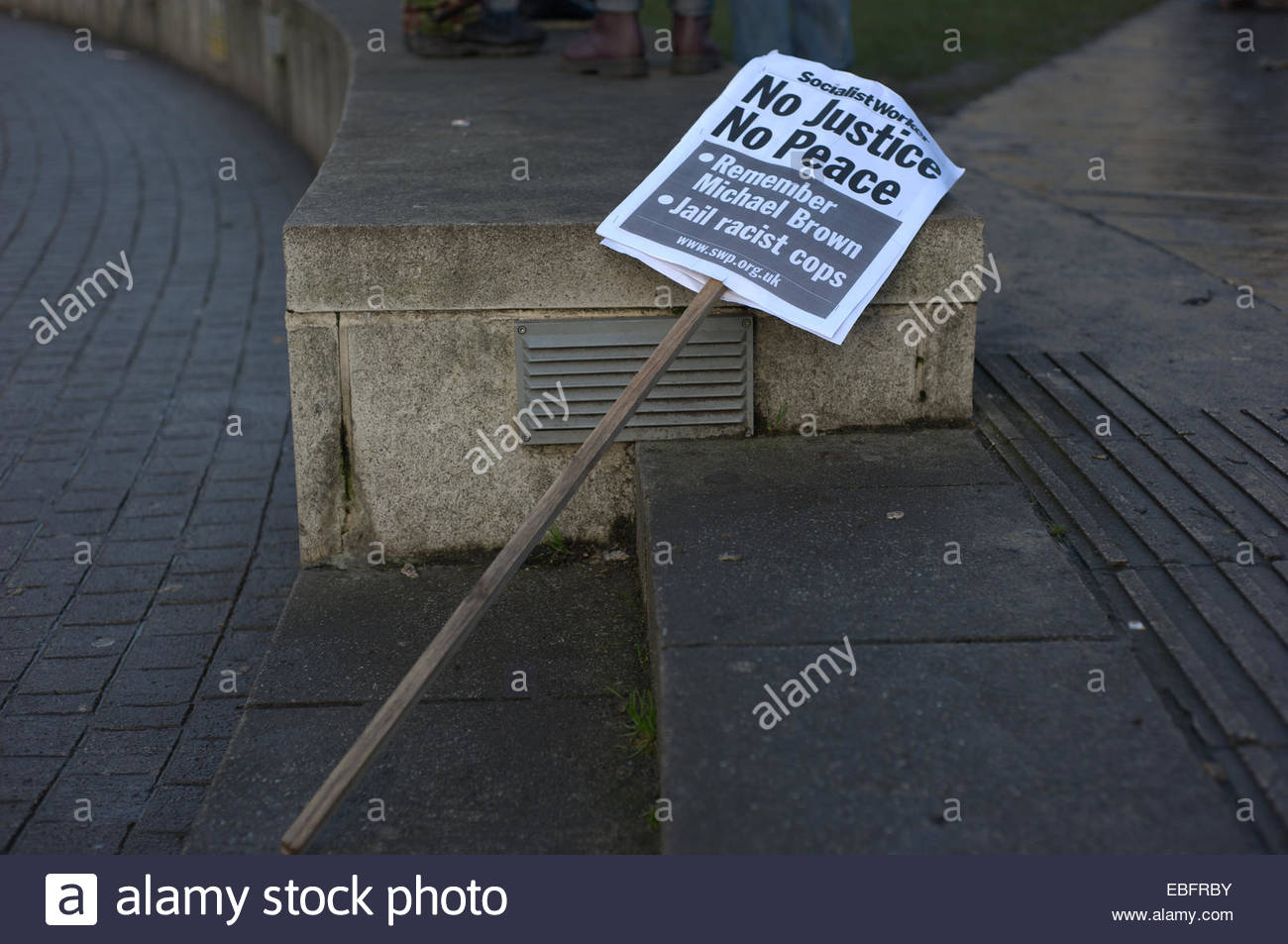 A placard laying on the ground. People of different ethnicities joined together and held a rally and march to remember - Stock Image