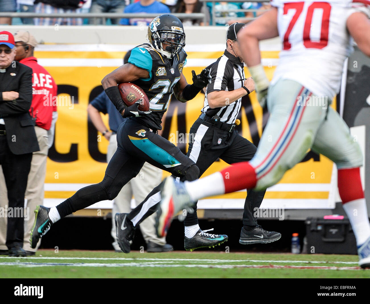 Jacksonville, FL, USA. 30th Nov, 2014. Jacksonville Jaguars cornerback Aaron Colvin (22) recovers a fumble by New - Stock Image