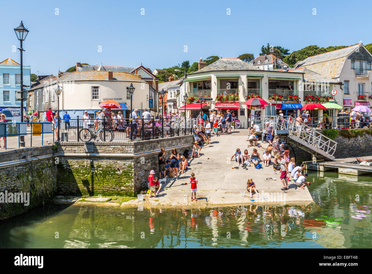 A Panoramic view of holidaymakers enjoying Padstow Harbour Cornwall, England UK - Stock Image