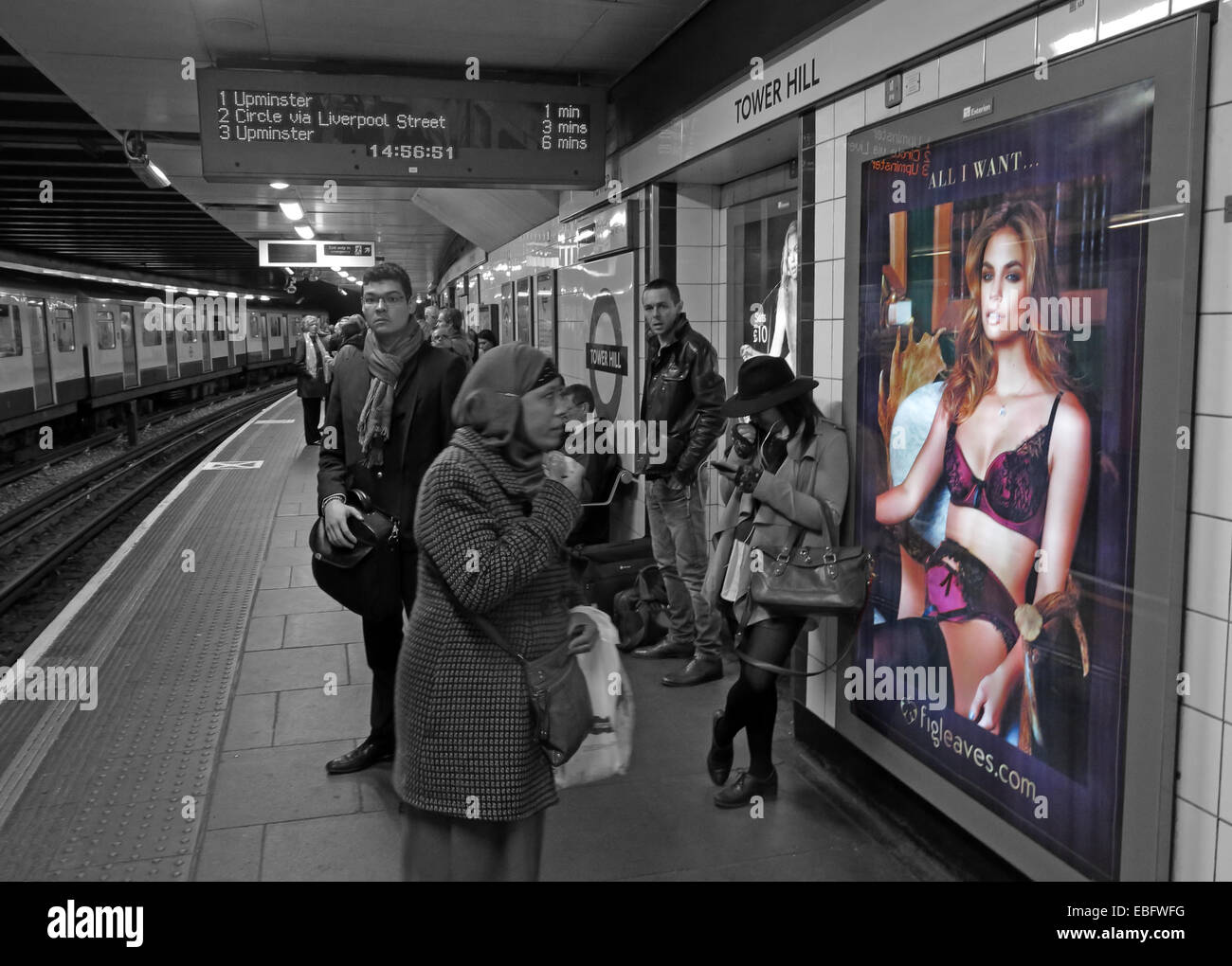 'All I want' poster for lingerie at Moorgate, London City Underground platform, England, UK in selective colour Stock Photo