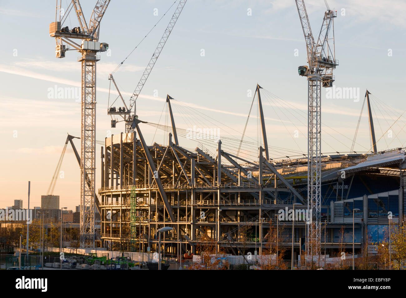 Steelwork and cranes at the City of Manchester Stadium (Etihad Stadium) expansion works, Clayton, Manchester, England, - Stock Image