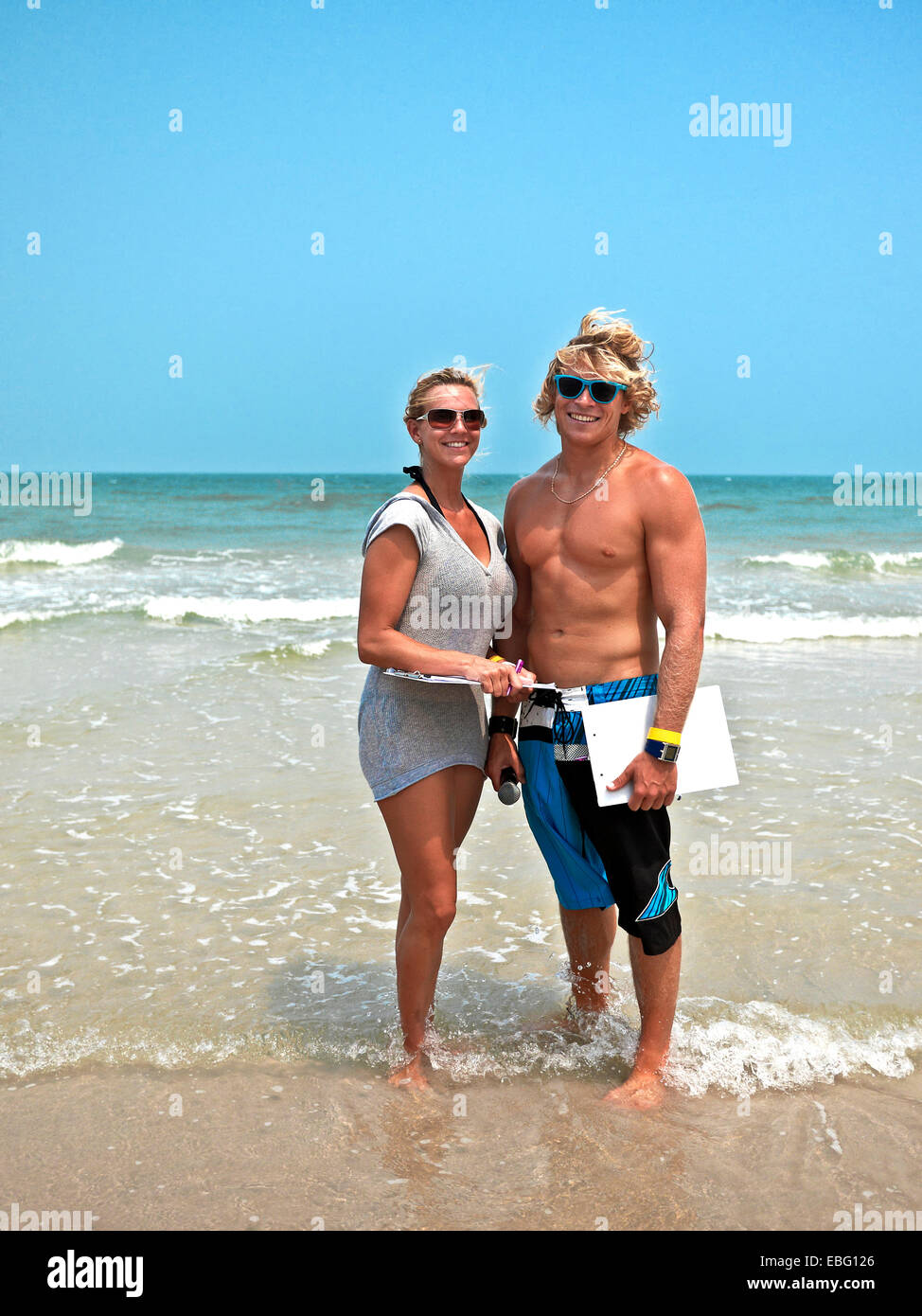 Good looking young blond haired couple smiling at camera on a Thailand beach location. S. E. Asia - Stock Image