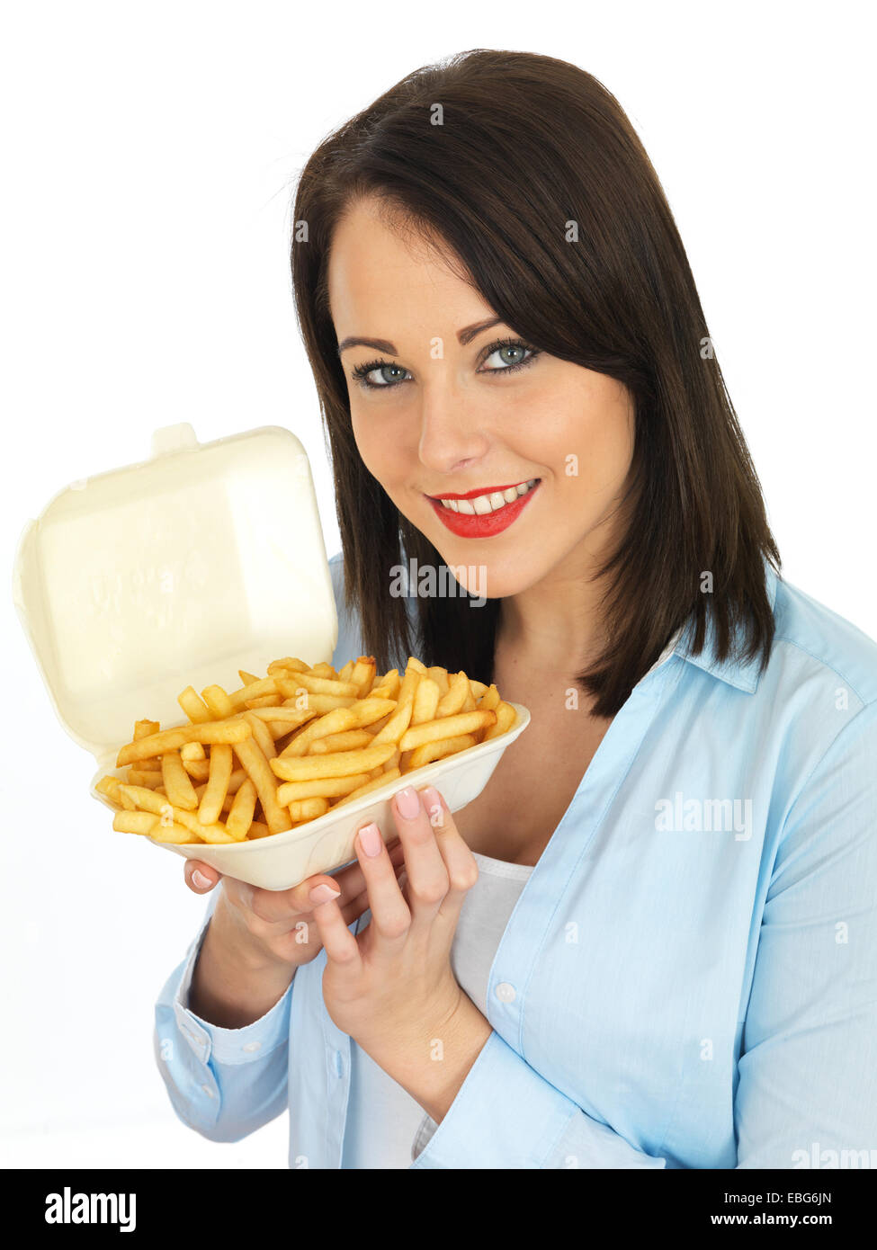 Attractive Twenty Something Young Woman Eating Chips - Stock Image
