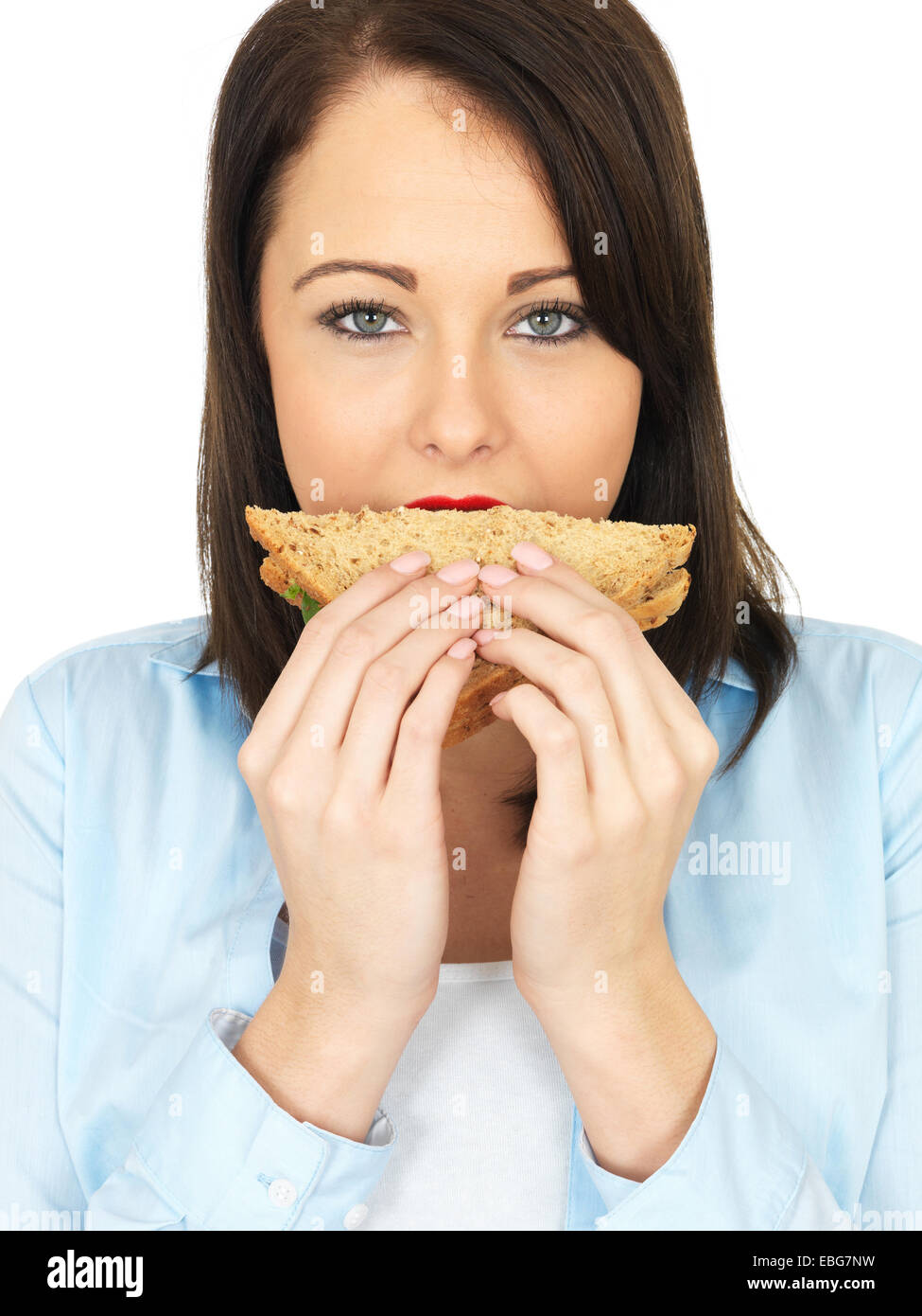 Attractive Twenty Something Young Woman Eating a Sandwich - Stock Image