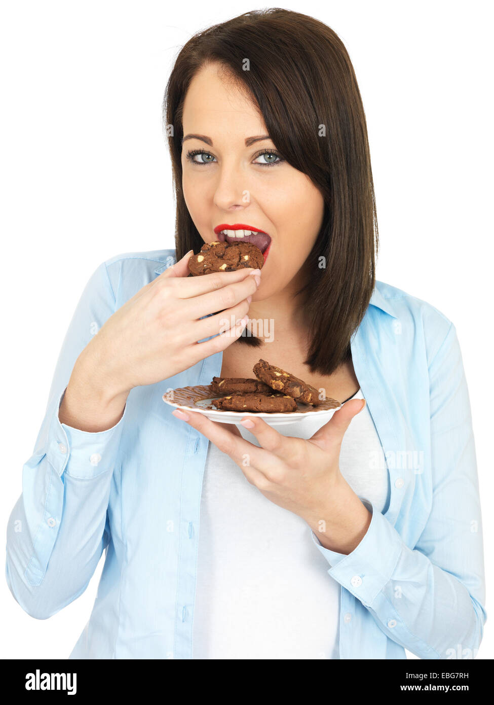 Attractive Twenty Something Woman Eating Biscuits - Stock Image