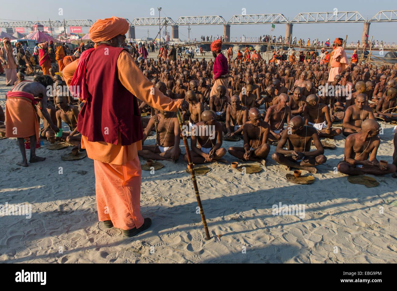 Taking their first meal in their new lives as part of the initiation of new sadhus at the Sangam, the confluence - Stock Image