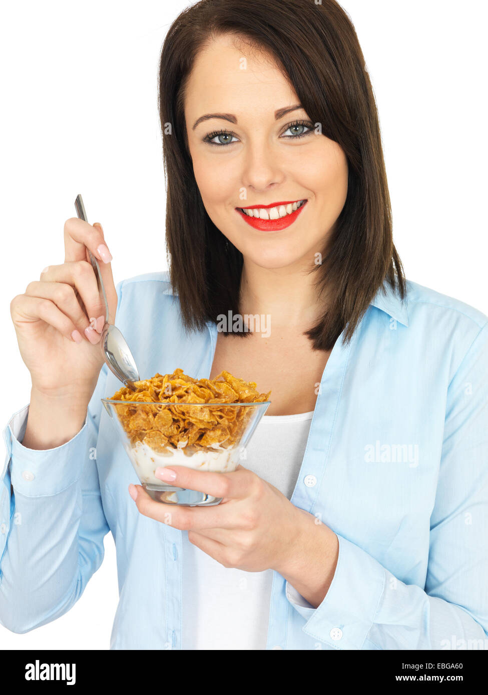 Young Attractive Twenty Something Woman Eating Breakfast Cereals - Stock Image