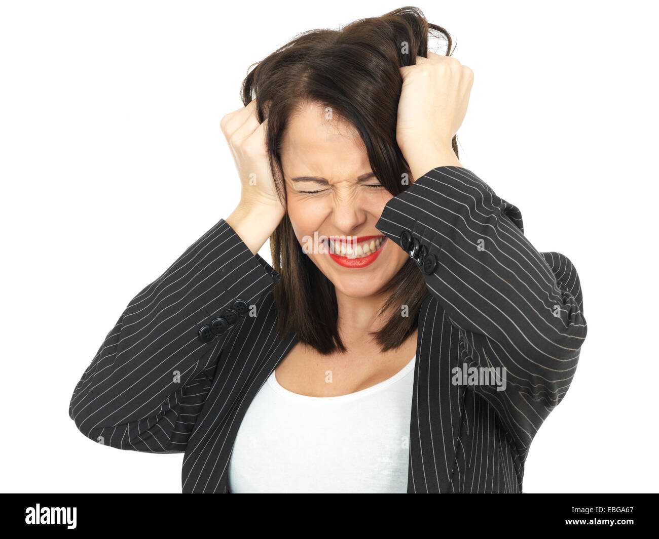 Angry Upset Young Business Woman Pulling Hair - Stock Image