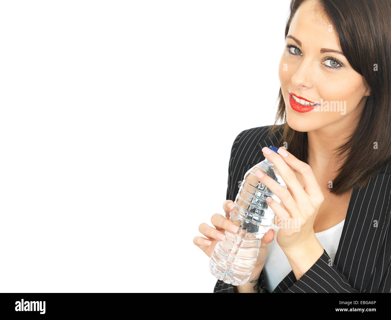 Attractive Business Woman Drinking a Bottle of Water - Stock Image