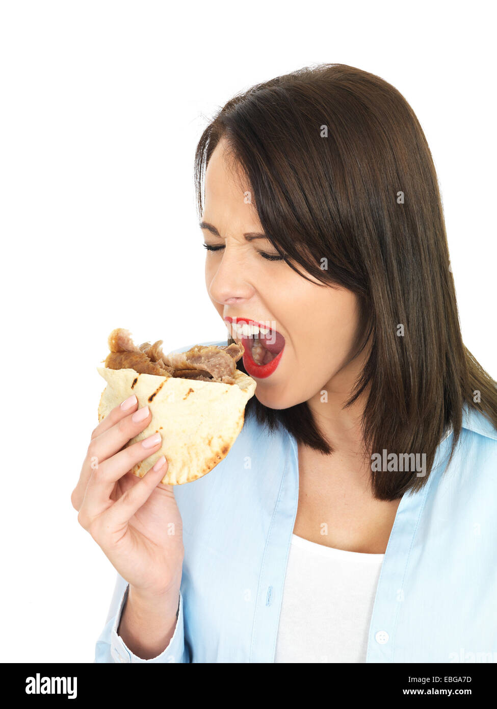 Attractive Young Twenty Something Woman Eating Donner Kebab - Stock Image