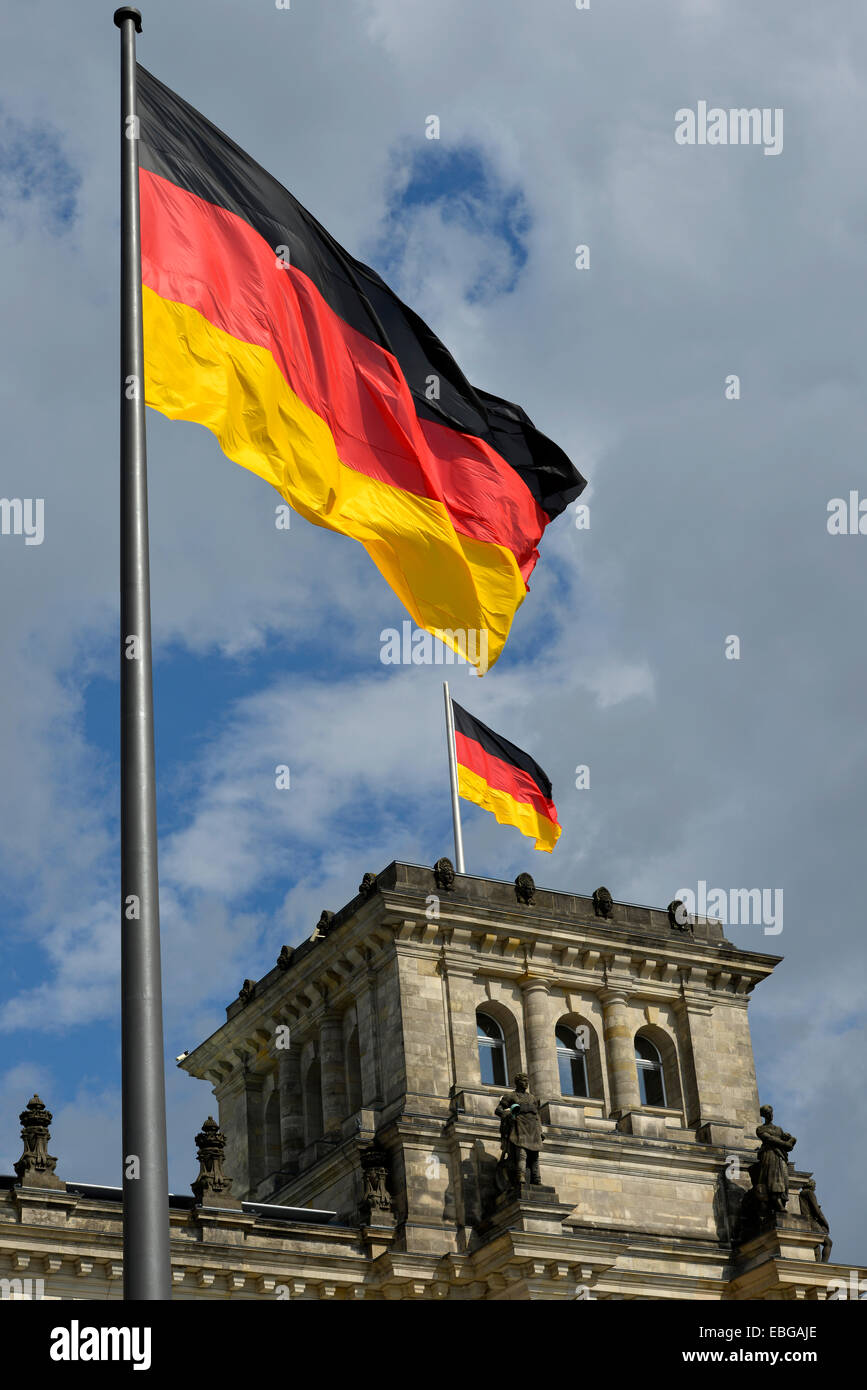 German flags flying on the Reichstag Building, Bundestag, parliament, Government District, Berlin, Berlin, Germany - Stock Image